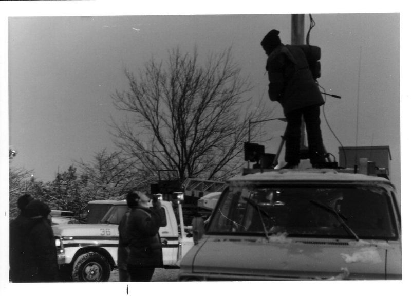 Television crew setting up for a live shot.