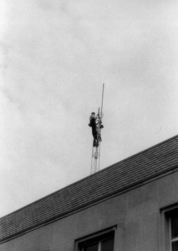 Tower crew high above the South Campus Dining Hall.